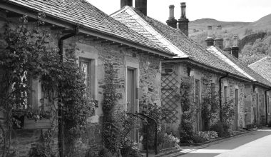 Black and white photo of old style houses on a lane