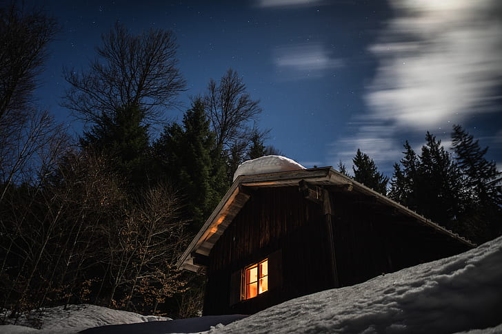 A cabin covered in snow