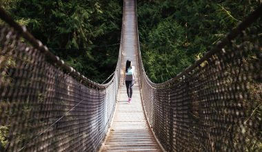 Woman walking on an swing bridge