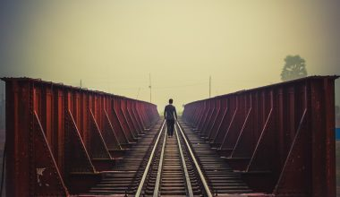 A person walking down a train track