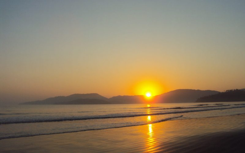 A photo of the sun setting at the beach